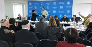 Roundtable host Adel Dianova of Hesed-Arieh Lviv presents awards to activists of Dobromyl for their work preserving local Jewish heritage