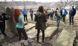 Marla speaking to the tour group at Rohatyn's new Jewish cemetery
