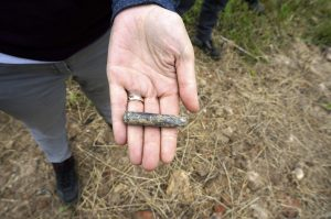 The shell of a rifle bullet is found