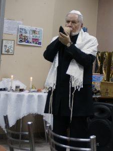 Blowing the shofar to celebrate Rosh Hashana