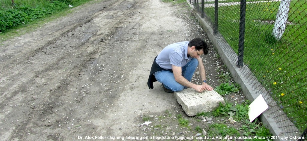 Dr. Alex Feller cleaning a headstone fragment found at roadside in Rohatyn