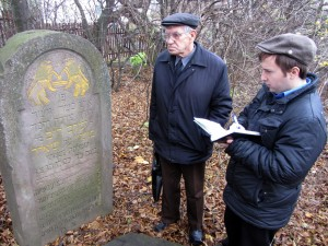 Jeremy translating one of the new cemetery headstones