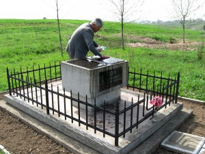 Mr. Vorobets cleaning the descendants' monument at the southern memorial