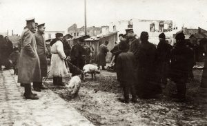 Soldiers and residents of Rohatyn on the market square ca. 1916