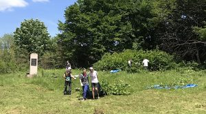 Pre-survey site clearing in progress at the new Jewish cemetery