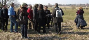 Marla with Father Debois at the Jewish cemetery and mass grave in Busk