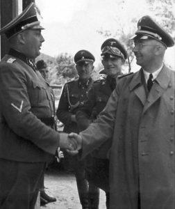 Katzmann standing behind Himmler at right