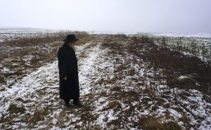 Rabbi Kolesnik at the mass grave site, 75 years after